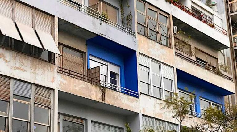 View of a Blue Condominium Part